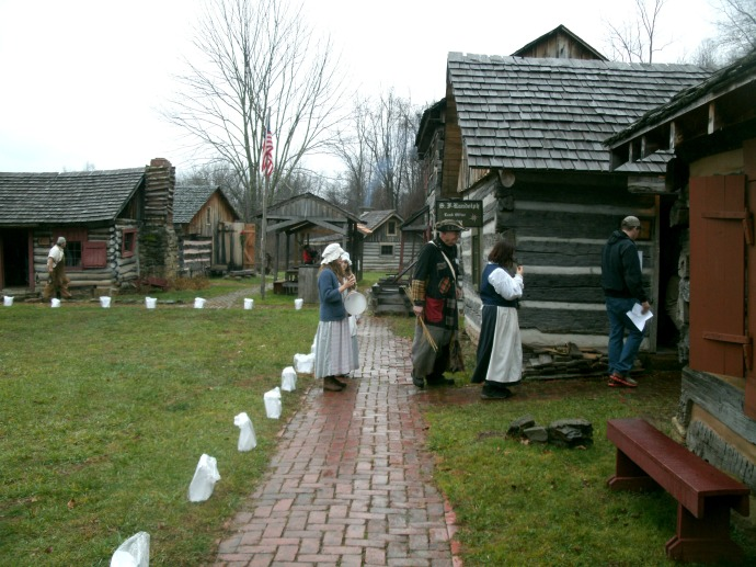 The Village at Fort New Salem with woman in period clothing