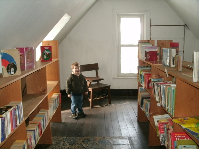 Christopher in the Attack of the Louis Bennett Library. Front peak room full of used Children's books