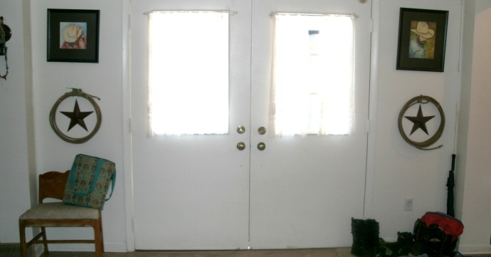 inside of all white entryway before update