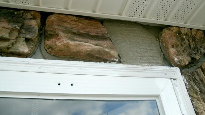 missing stone tile from upper door suround