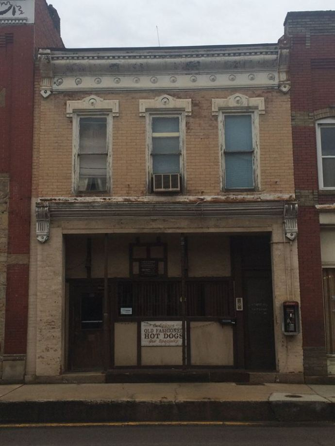 Store Front of Sunshine building before repairs begin