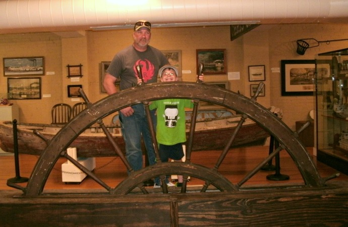 Tom and Christopher with antique ship steering wheel Blennerhassett Island Museum. Parkersburg, West Virginia