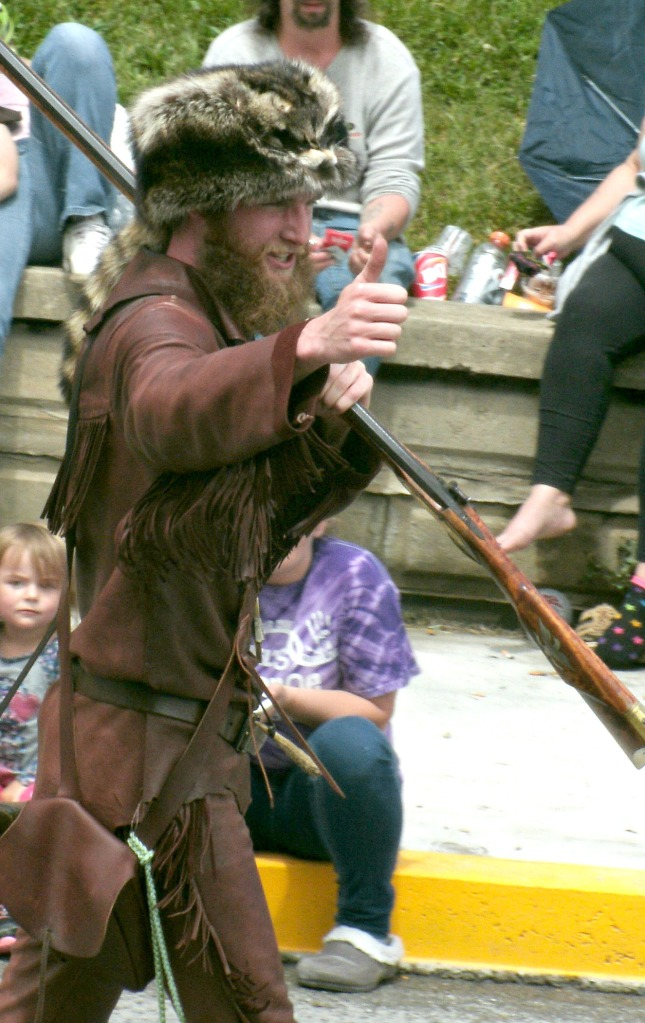 WVU's Mountaineer mascot takes time to walk in the parade