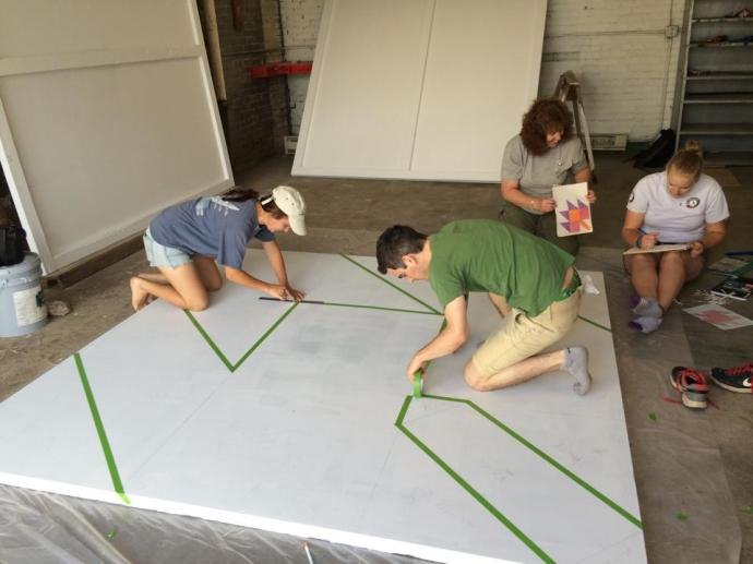 AmeriCrops working on Hertiage Quilt Block Panels