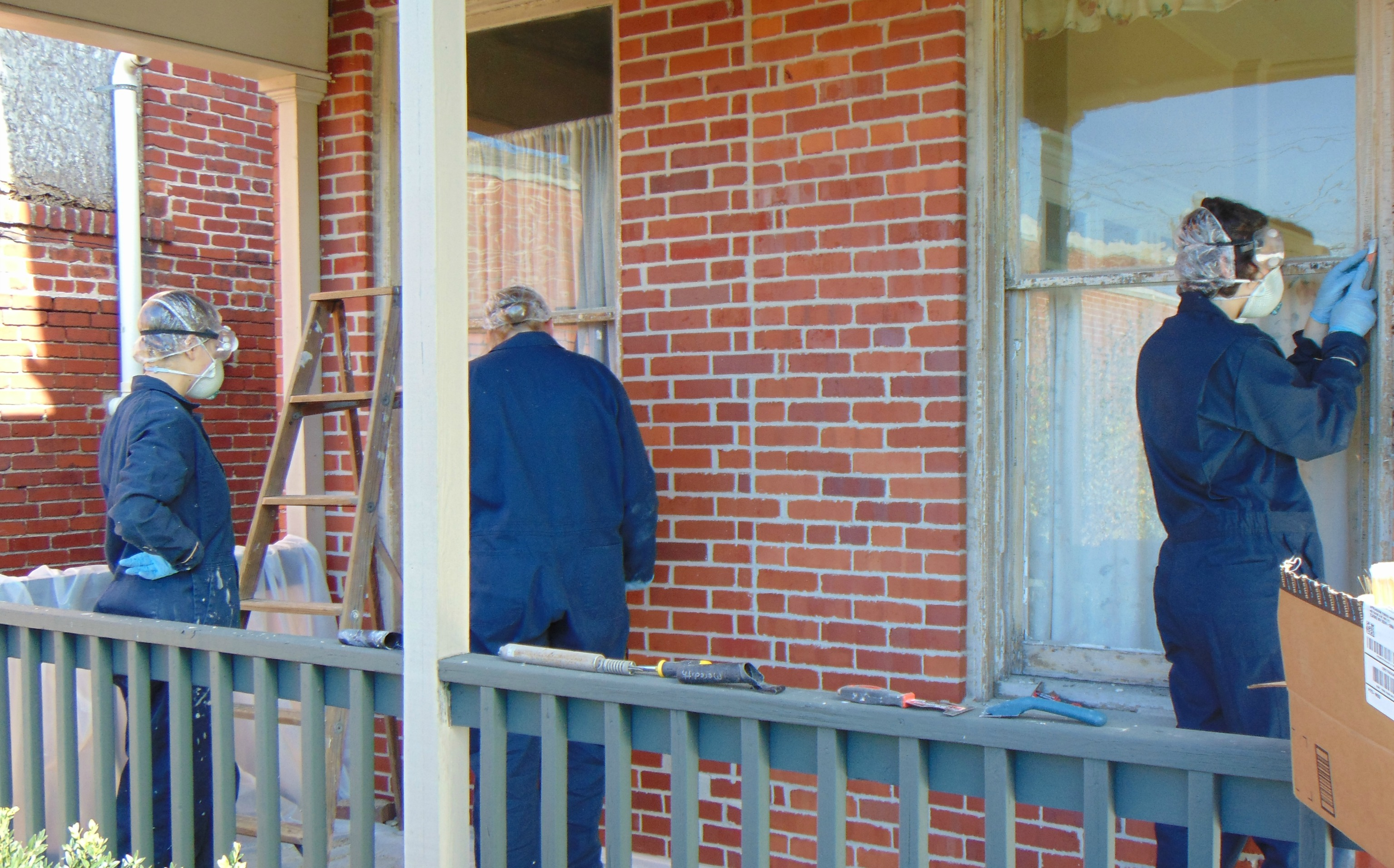 hands-on-team-working-to-reglaze-and-paint-windows-at-the-historic-darden-house-elkins-west-virginia