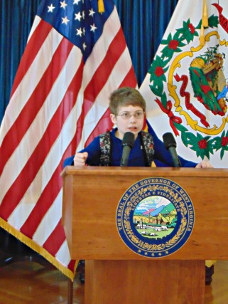 Christopher giving a speak at the Governs Official Podium