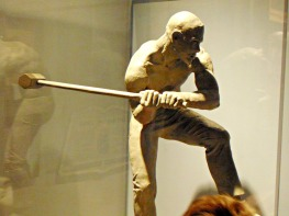 sculpture of John Henry trying to beat the digging machine. the true story happened in southern WV