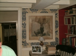 print of the Hartford Red Stag in living area of George B Evans home