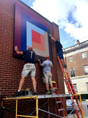 Log Cabin Quilt Block being installed in Downtown Elkins WV