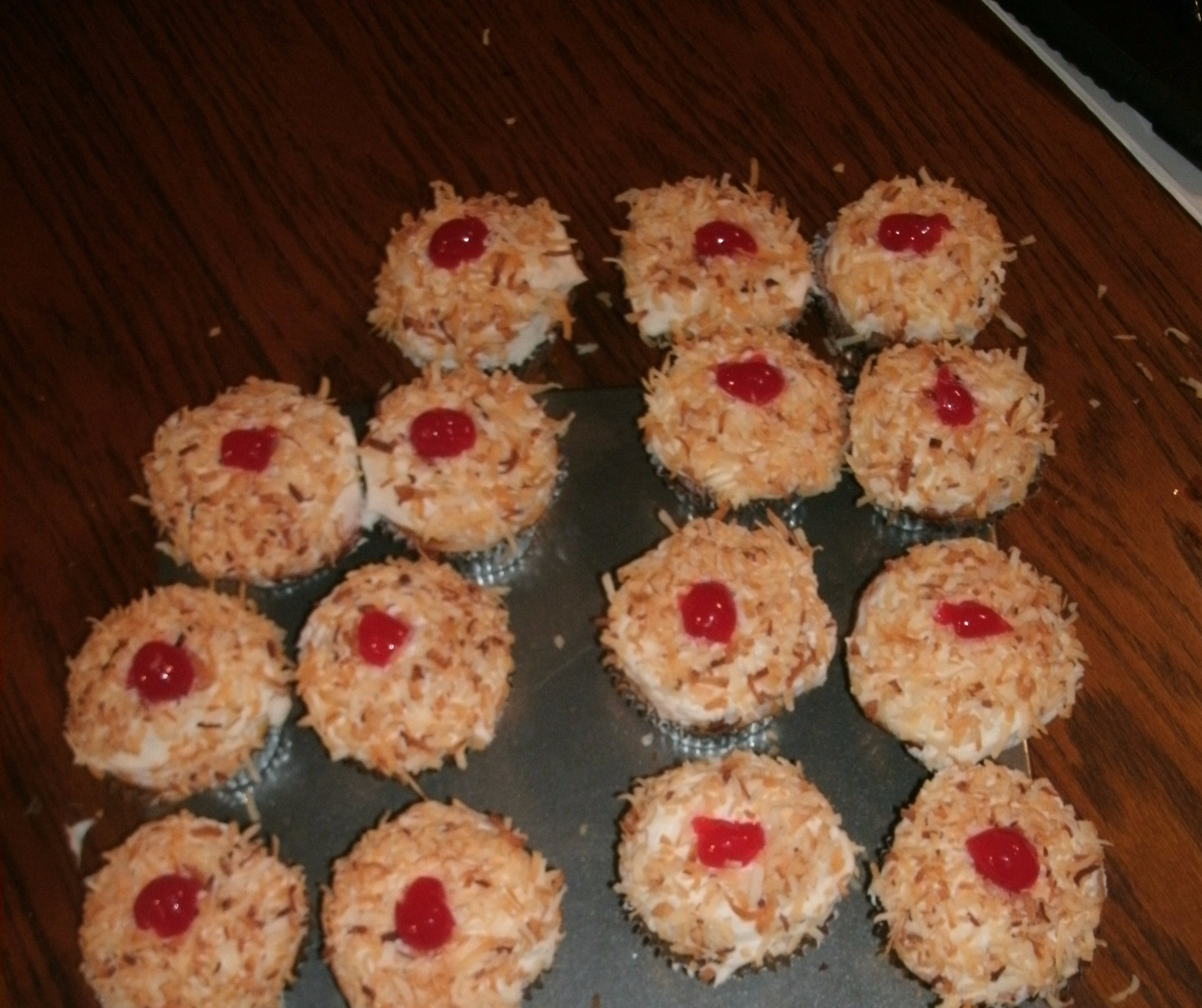 Coconut cupcakes with Almond buttercream icing and toasted coconut topping.