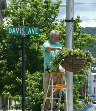 Doug Starcher working on downtown flowers spring of 2017