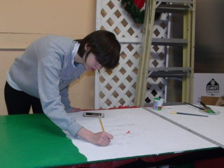 Alexa an AmeriCorps Volunteer helping with murals for Golden Rule