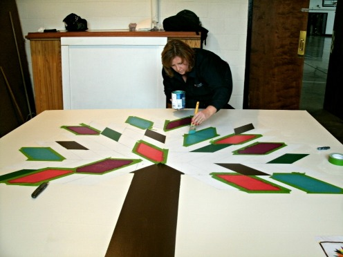 Citizens bank Volunteer help to paint their mural Tree of Life