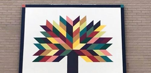 Tree of Life Quilt Block on the side of Citizens Bank in Elkins WV