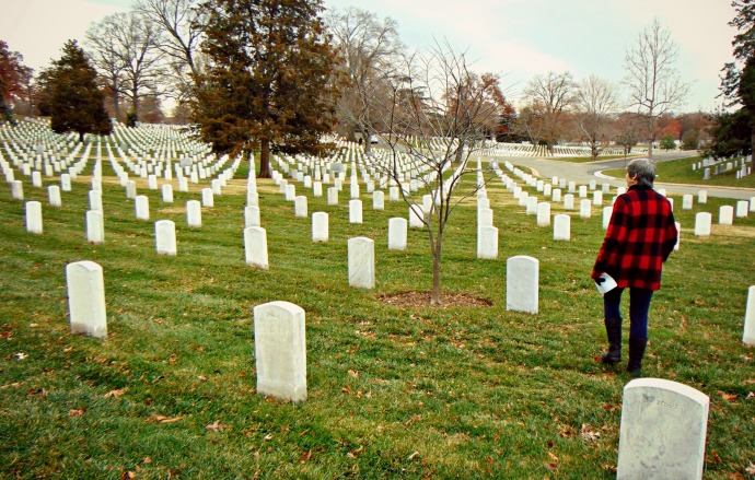 Row after row of head stones at Arlington National Cemetery with Kathryn Robinson