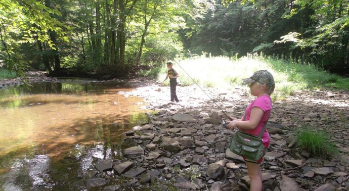 Paige and Christopher fishing in the Laural Fork near Rich Mountain