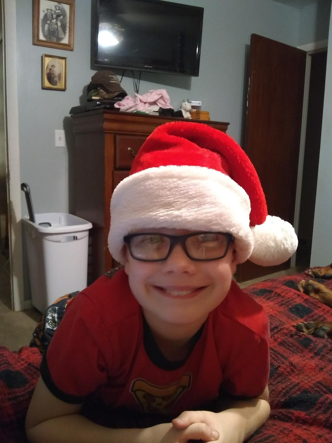 Christopher in santa hat