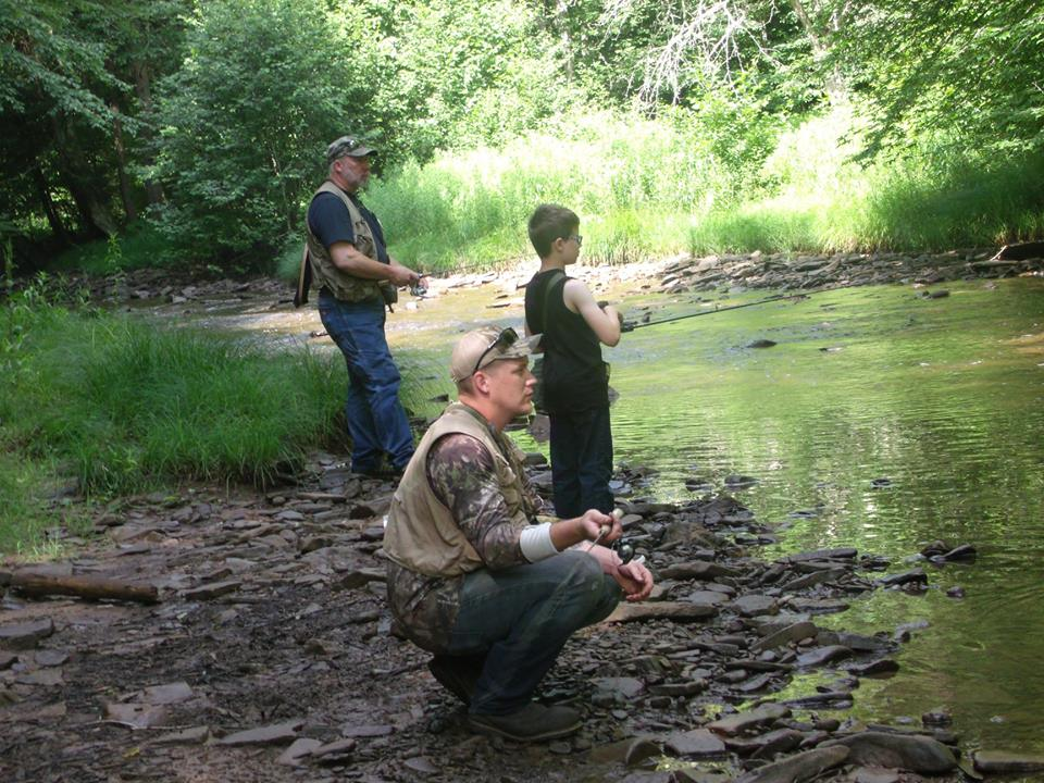 the Powers Men fishing off of Laural Fork river near Rich mountain