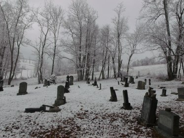 view of headstones in the snow