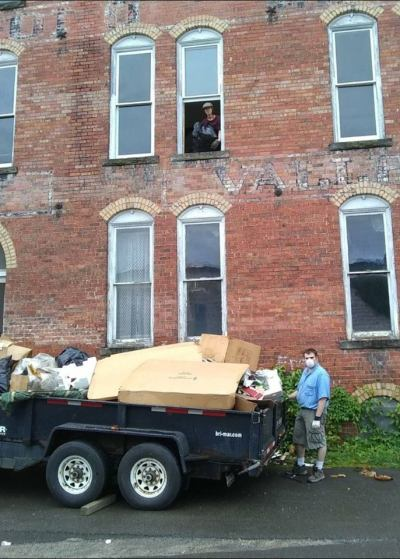 logan and Patrick AmeriCorps members volunteer to toss out 4,000 pounds of trash