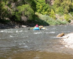 A rafting trip floats by us on the Colorado river