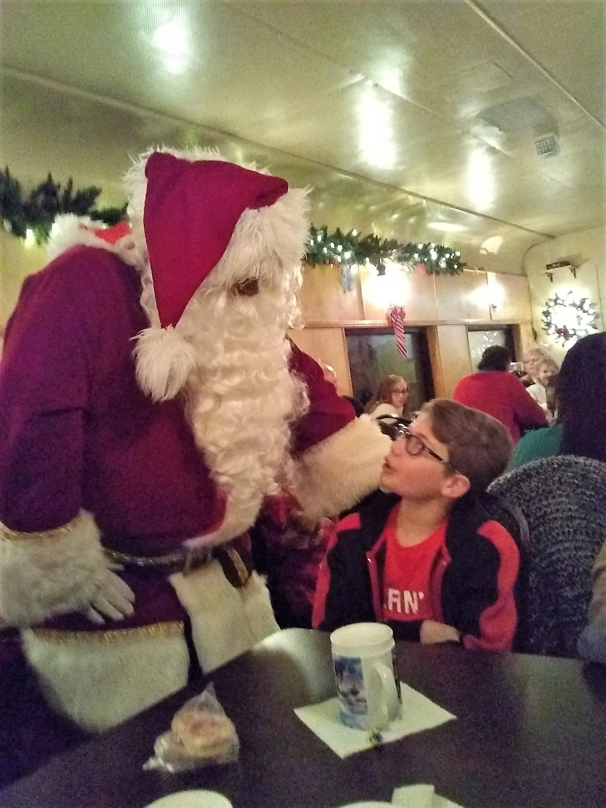 Christopher with santa on the polar express
