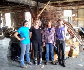 AmeriCorps Volunteers help with trash removle at the Golden Rule