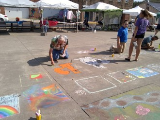 Community member add art to the fall festival